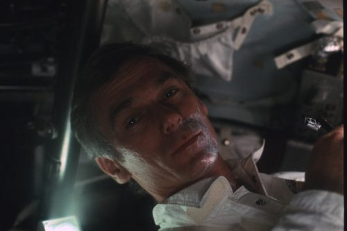 Gene Cernan spruces himself up on the way to the Moon. Credit: NASA