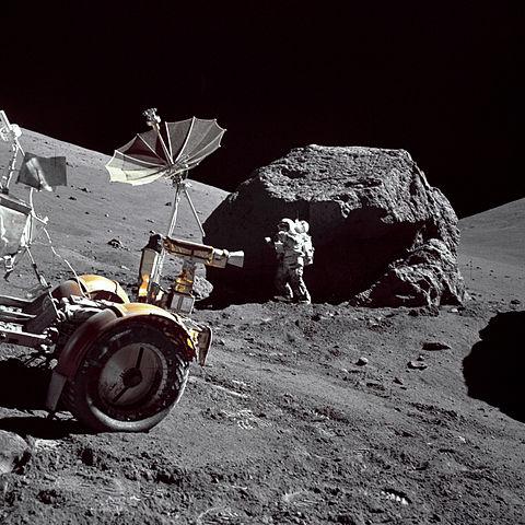 Schmitt next to big boulder on the Moon
